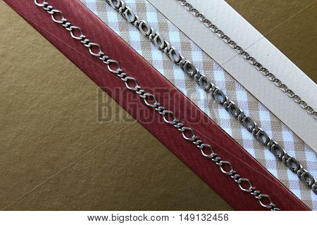 Simple composition of everyday jewelry with gold background