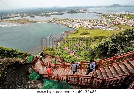 Jeju Island - 5 October 2014: High angle view of international tourists and landscape image from top of crater Jeju Volcanic as