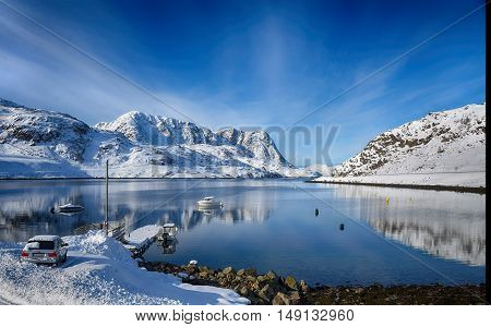 Norwegian landscape, tranquil sea and the white snow