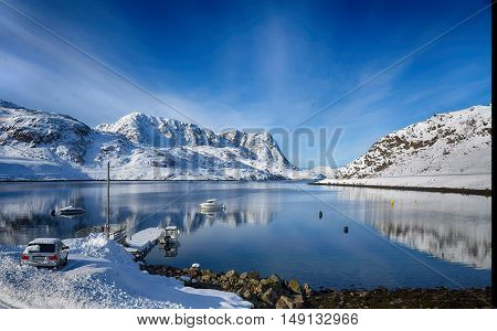 Norwegian winter landscape of sea and snow