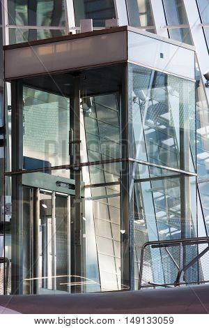 Glass elevator shaft in a modern building in the Netherlands