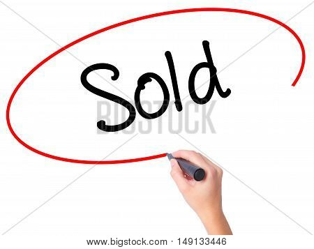 Women Hand Writing Sold With Black Marker On Visual Screen