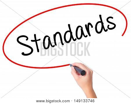 Women Hand Writing Standards With Black Marker On Visual Screen