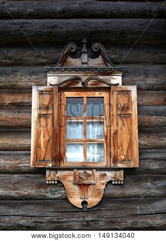 Wooden bird of happiness - carved decoration Russian ridge roof. Traditional architecture of the Russian countryside. Russia.
