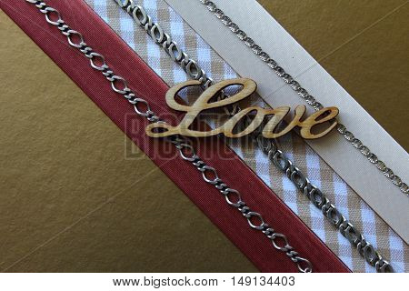 Simple composition with everyday jewelry and text.