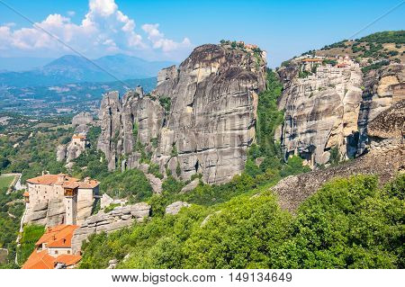 Rock formations of the Meteora with Monastery of Roussanou St. Nicholas Anapausas Great Meteora and Varlaam. Meteora Plain of Thessaly Greece Europe