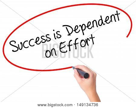 Women Hand Writing Success Is Dependent On Effort With Black Marker On Visual Screen
