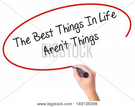 Women Hand Writing The Best Things In Life Aren't Things With Black Marker On Visual Screen