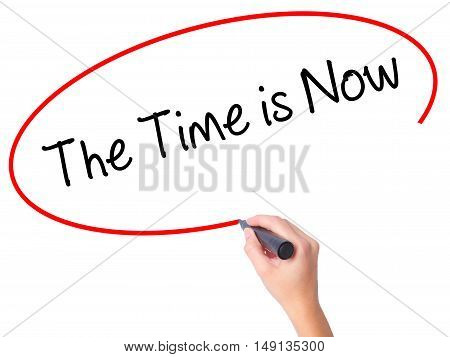 Women Hand Writing The Time Is Now With Black Marker On Visual Screen
