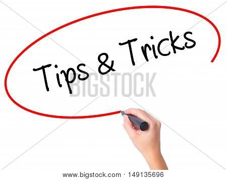 Women Hand Writing Tips & Tricks With Black Marker On Visual Screen