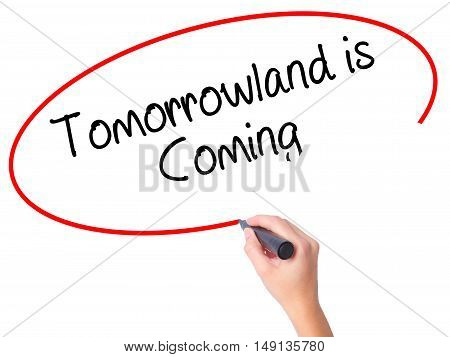 Women Hand Writing Tomorrowland Is Coming With Black Marker On Visual Screen