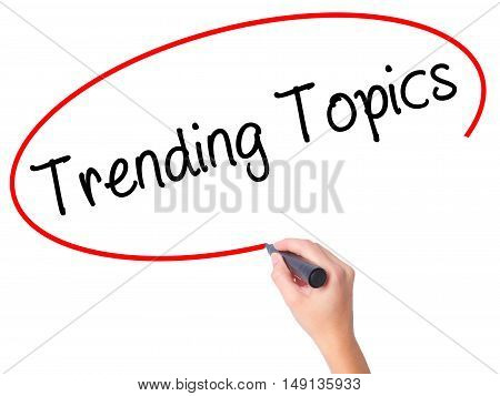 Women Hand Writing Trending Topics With Black Marker On Visual Screen