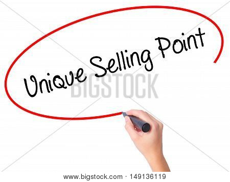 Women Hand Writing Unique Selling Point With Black Marker On Visual Screen