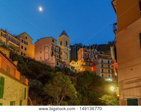 The old narrow street in the medieval Italian village of Manarola at night. Parco Nazionale delle Cinque Terre Liguria Italy.