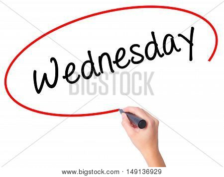 Women Hand Writing Wednesday  With Black Marker On Visual Screen