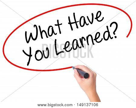 Women Hand Writing What Have You Learned? With Black Marker On Visual Screen