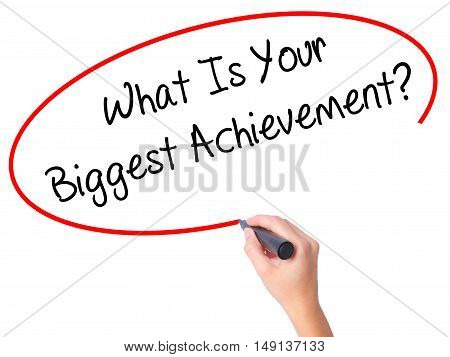 Women Hand Writing What Is Your Biggest Achievement? With Black Marker On Visual Screen