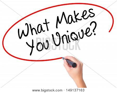 Women Hand Writing What Makes You Unique? With Black Marker On Visual Screen
