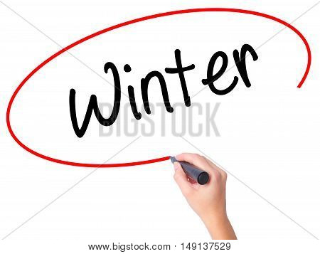 Women Hand Writing Winter With Black Marker On Visual Screen
