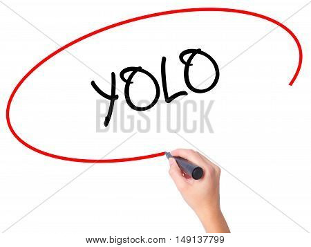 Women Hand Writing Yolo (you Only Live Once) With Black Marker On Visual Screen