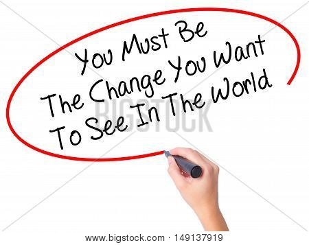 Women Hand Writing You Must Be The Change You Want To See In The World With Black Marker On Visual S