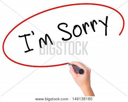Women Hand Writing I'm Sorry With Marker On Transparent Wipe Board