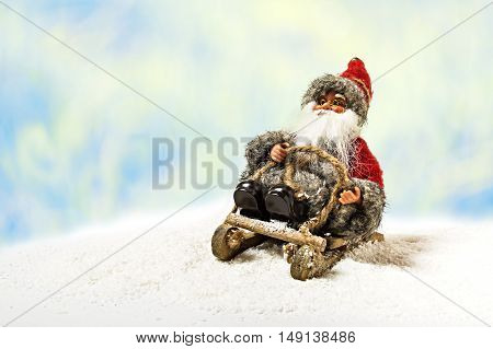 Cheerful Christmas Santa Claus Toy On Snowdrift