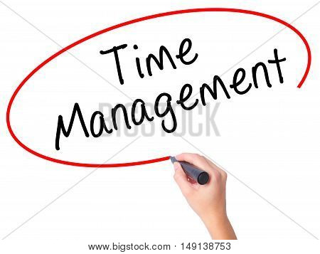 Women Hand Writing Time Management With Black Marker On Visual Screen