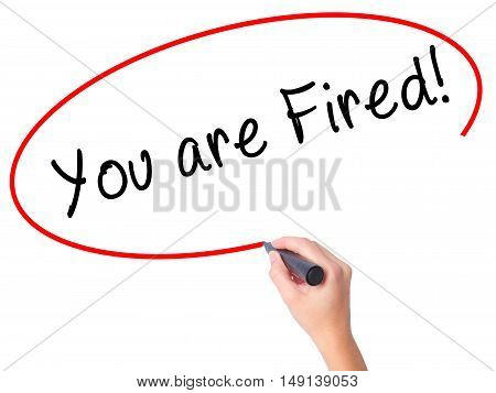 Women Hand Writing You Are Fired! With Black Marker On Visual Screen