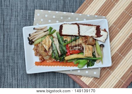 Fried mixed vegetables with tofu in Vegetable festival of Chinese. Top view.