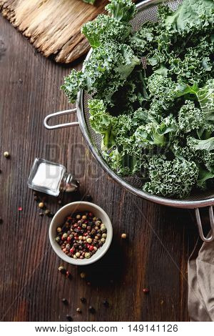 Fresh Chopped Kale Italian Salad On Old Wooden Board With A Knif