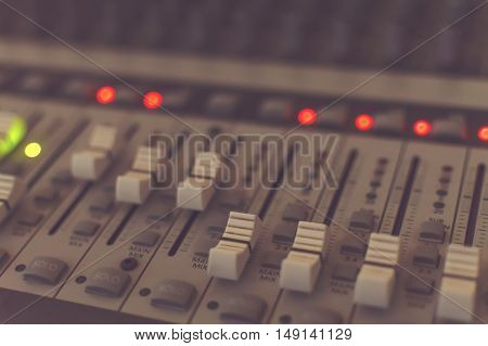 Sound mixing desk. Close up view. Shallow depth of field.