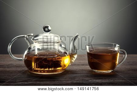 teapot and cup of tea on a wooden table