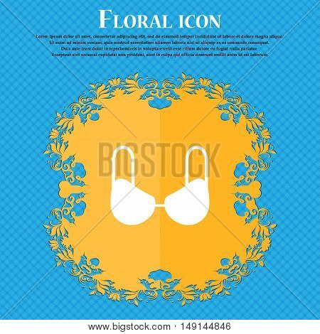 Brassiere Top Icon Sign. Floral Flat Design On A Blue Abstract Background With Place For Your Text.