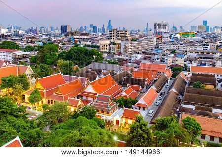 Traditional architecture of Bangkok from the height of bird flight, Thailand. View of Bangkok from Golden Mountain at sunset, Thailand.