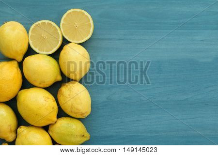 Acid and yellow fruit. Lemons on a blue wood