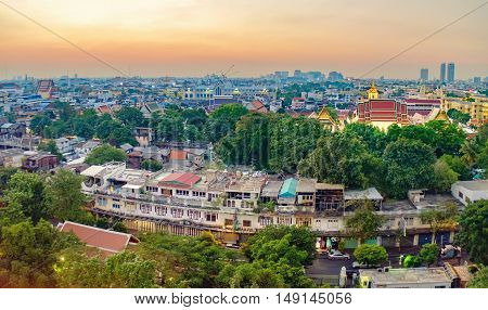 Traditional architecture of Bangkok from the height of bird flight. View of Wat Ratchanatdaram Temple from Golden Mountain at sunset, Thailand.