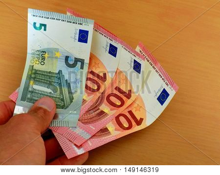 Men holding euro banknotes money, business finance