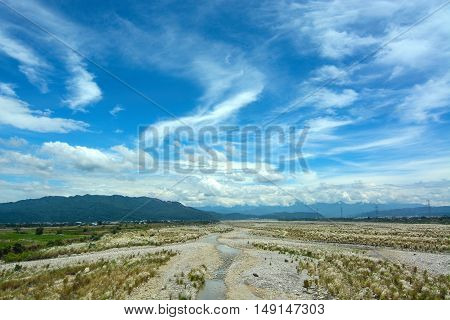 Rocky riverbed and blue summer sky in Yunlin County, Taiwan