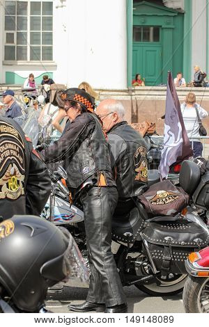St. Petersburg, Russia - 13 August, Women and motorcycles.,13 August, 2016. The annual parade of Harley Davidson in the squares and streets of St. Petersburg.