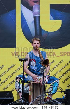 St. Petersburg, Russia - 13 August, Musician national wooden pipe,13 August, 2016. Africa and the Russian Culture Festival on Krestovsky Island in St. Petersburg.