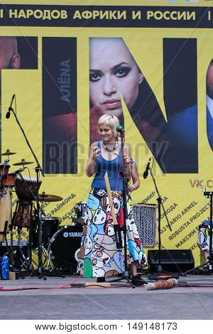 St. Petersburg, Russia - 13 August, Soloist at the microphone,13 August, 2016. Africa and the Russian Culture Festival on Krestovsky Island in St. Petersburg.