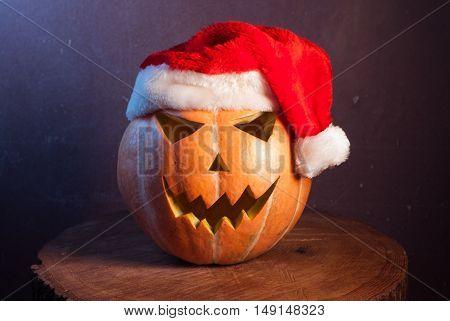 Jack-o ' - lantern in a red Santa hat, happy holidays