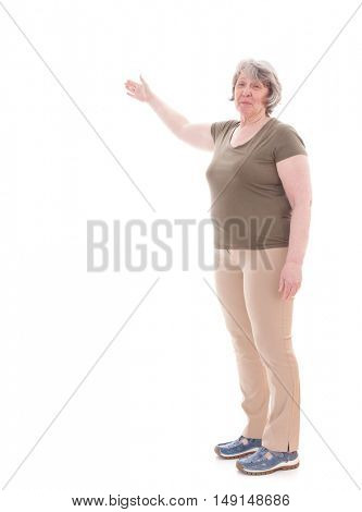 Senior woman pointing to the side. All on white background.