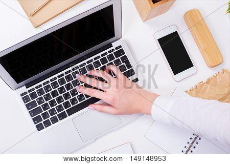 Woman Typing On Keyboard Closeup