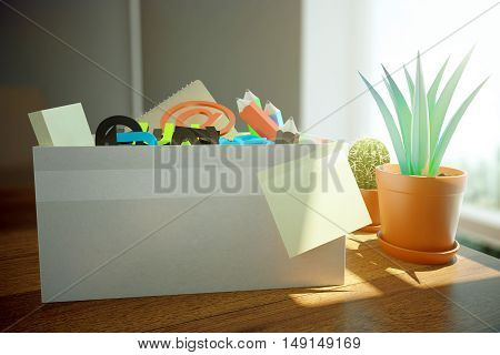 Closeup of box full of stationery items blank sticker a dn decorative plant on wooden desktop with daylight. 3D Rendering