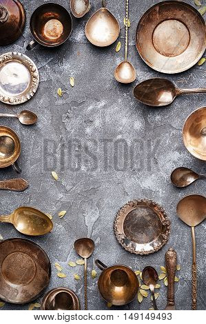 Collection of old cutlery on a gray textural background with copy space