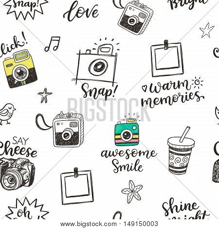 Seamless pattern with hand drawn doodle sketch photocameras and photographic phrases