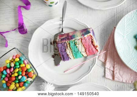 Colorful cake slice on white festive table