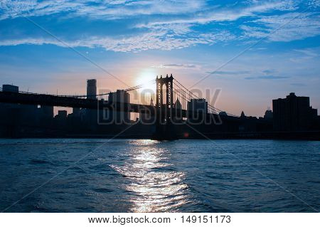 New York, NY, United States - 20 June 2010 Brooklyn Bridge in New York City at dawn. A view of the Brooklyn Bridge at sunset. Hudson and the sky a deep blue.